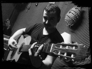 "David Laga ""Tute"" - Voces y guitarra"